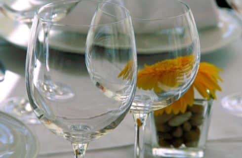 Close up view of empty wine glasses on a set dining table